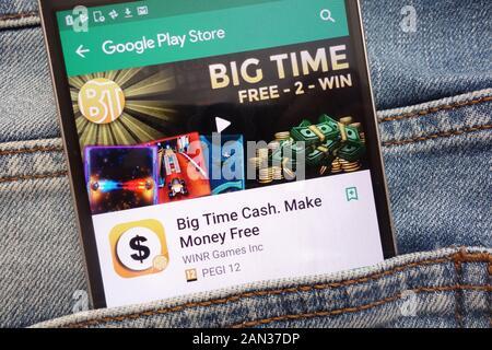 Big Time Cash. Make Money Free app on Google Play Store website displayed on smartphone hidden in jeans pocket - Stock Photo
