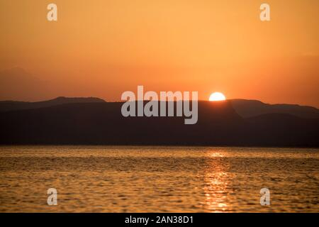 Sunset over the Sea of Galilee, Israel's largest freshwater lake - Stock Photo