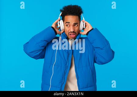 Cringing And Bothered African American Man Grimacing Hearing Bad Sound Quality Of Headphones Dont Like Song Take Off Earphones And Making Unsatisfied Stock Photo Alamy