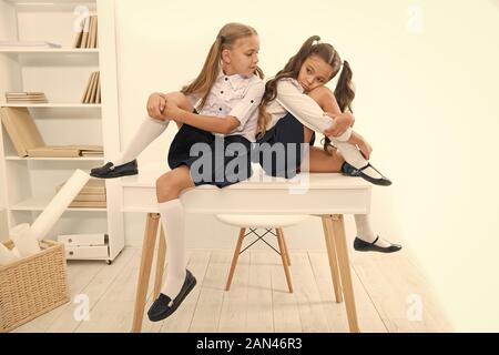 Bored Children Sitting At Table During Bithday In Yard Stock Photo