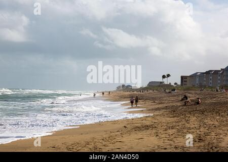 Tourists watch the choppy surf from this Hutchinson Island beach at Stuart, Florida, USA. - Stock Photo
