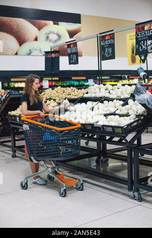 Beautiful happy women shopping vegetables and fruits at the supermarket