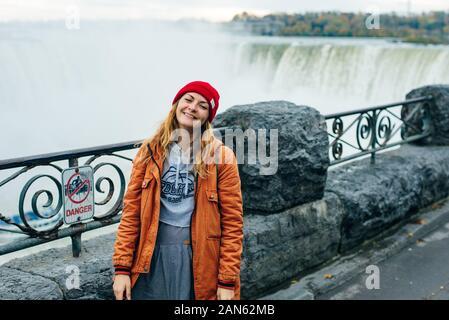 NIAGARA FALLS - CANADA, december 2019 Horseshoe Falls from the Canadian side of Niagara Falls with tourists - Stock Photo