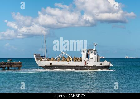 Les Trois-Ilets, Martinique - December 13, 2018: A French landing craft with soldiers at the pier in Anse-a-l'Ane bay, Les Trois-Ilets, Martinique. - Stock Photo