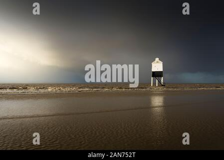 Stomy sky over the low lighthouse on the beach at Burnham-on-Sea, Somerset, England. - Stock Photo
