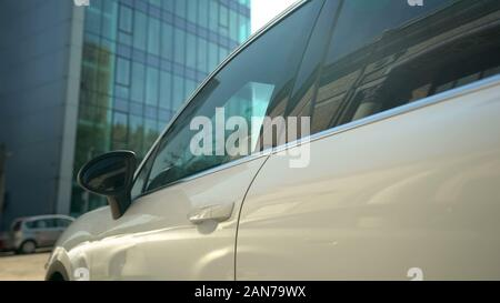Company suv standing on parking lot, business car, renting or leasing system - Stock Photo