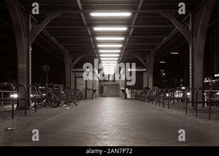 Stairs to the platform of a subway station in Berlin, entrance to the subway station Görlitzer Strasse, Berlin Kreuzberg, night shot, black and white