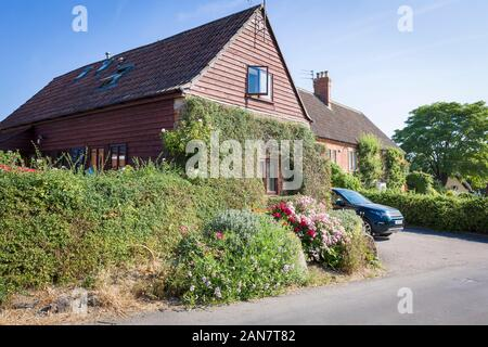 Informal roadside garden in front of modern chalet bungalow in Heddington near Calne Wiltshire England UK - Stock Photo
