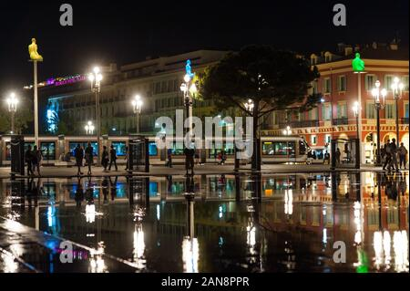 Nice, France - 16th may 2015: Tram passing through Place Massena in downtown Nice at night - Stock Photo