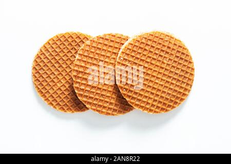 Food Concept Stroopwafel, crispy caramel syrup Dutch waffles isolated on white background - Stock Photo