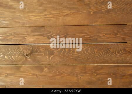 Painted wooden background with visible annual rings and knots
