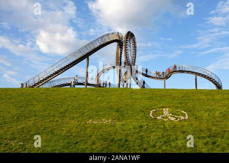 Tiger and Turtle – Magic Mountain, an art installation and landmark in Angerpark, Duisburg, Germany Stock Photo