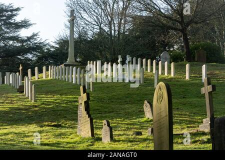 Aldershot Military Cemetery with graves of british and commonwealth servicemen and women, Hampshire, UK. First world war graves and cross of sacrifice - Stock Photo