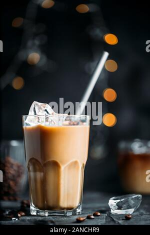 Iced coffee with milk in tall glass - Stock Photo