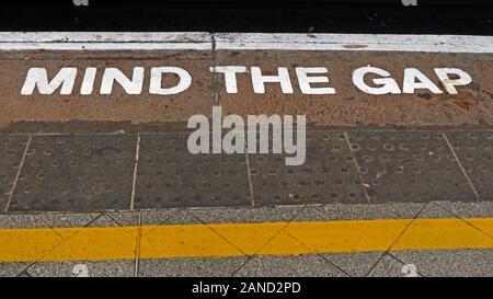 Mind The Gap, MindTheGap sign, railway station platform, England, UK - Stock Photo
