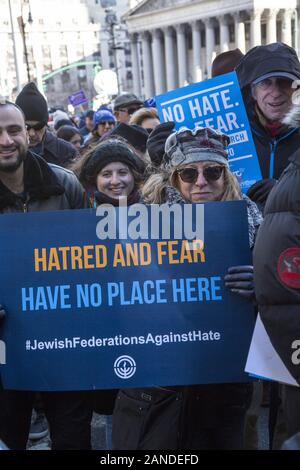 No Hate, No Fear Jewish Solidarity March in response to anti-semitic attacks in and around city across Brooklyn Bridge - Stock Photo