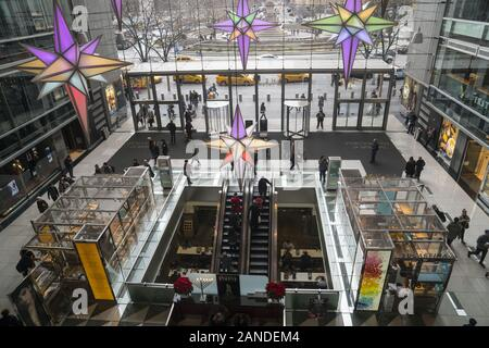 Main lobby of the Time Warner Building decorated for the holiday season at Columbus Circle across the street from Central Park in New York City. - Stock Photo