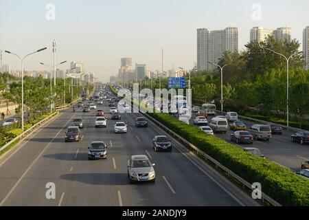 The eastern section of Beijing's fourth ring road at rush hour time on a sunny late afternoon in May. Beijing, China - Stock Photo