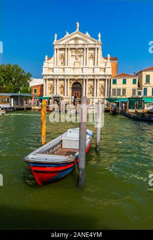 10 august 2019,Grand canal Venice Italy. A beautiful Boat in Grand canal Venice, and background on  Santa maria di nazareth church venice Grand canal - Stock Photo