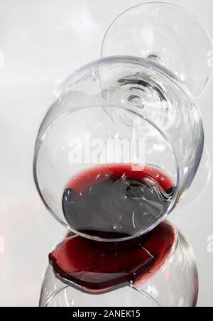 Knocked over glass of red wine and split liquid on a mirror. - Stock Photo