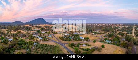 Wide aerial panorama of Australian countryside at dusk - Stock Photo