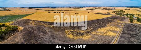 Wide aerial panorama of agricultural land in Australian outback - Stock Photo