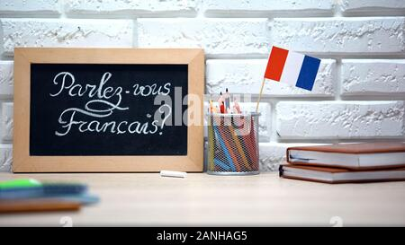 Do you speak French written on board, France flag standing in box, language - Stock Photo