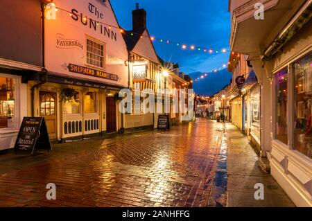 Christmas decorations in West Street in the historic market town of Faversham, Kent - Stock Photo