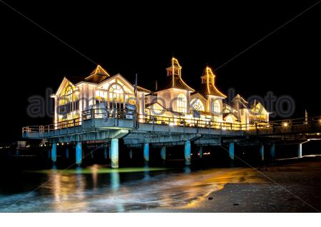 Night at the famous Sellin Seebruecke (Sellin Pier) in the Ostseebad Sellin tourist resort on Ruegen island in the Baltic Sea, Germany - Stock Photo