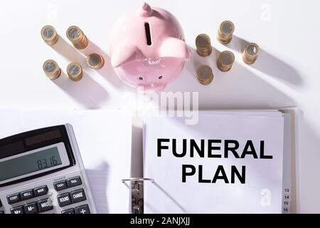 Funeral Plan Papers, Stack Of Coins And Calculator - Stock Photo