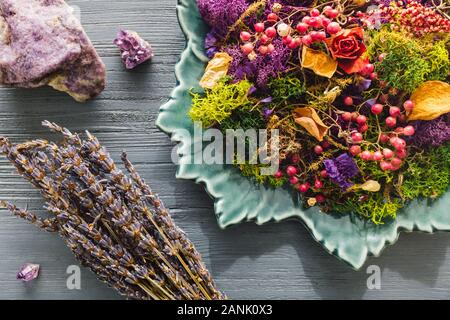 Plate of Dried Botanicals with Lepidolite and Amethyst Crystals - Stock Photo