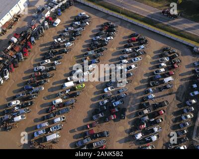 Drone aerial auto car junk yard near Great Miami River Ohio - Stock Photo