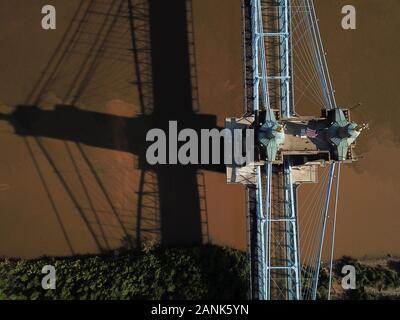 Drone Aerial Roebling suspension bridge over Ohio River downtown Cincinnati USA - Stock Photo