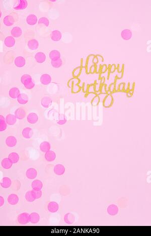 Creative pastel fantasy holiday card with cupcake and happy birthday lettering. Baby shower, birthday, celebration concept. Vertical - Stock Photo