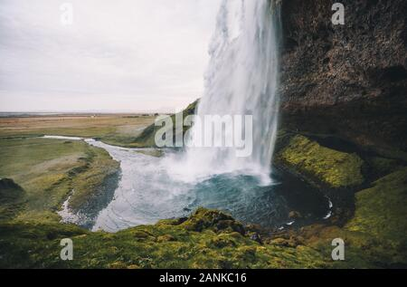 Perfect view of famous powerful Seljalandsfoss waterfall in sunlight. Dramatic and gorgeous scene. Location place Iceland, sightseeing Europe. Instagr