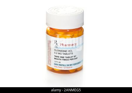 Clonidine ADHD and hypertension prescription medication container isolated on white. - Stock Photo