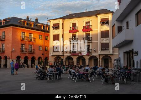 Locals gather for a drink at sunset in the main square of Ponferrada, Spain. This image was shot while walking El Camino de Santiago in Spain. - Stock Photo