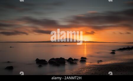 Milford Beach Sunrise in Auckland New Zealand - Stock Photo