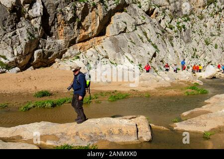 Hiker doing a nature walk. Nature environment natural park of Ardales. Malaga province, southern Andalusia. Spain Europe