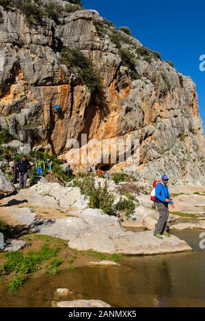 Hikers doing a nature walk. Nature environment natural park of Ardales. Malaga province, southern Andalusia. Spain Europe