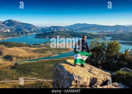 Hiker doing a nature walk. The three reservoirs, Count of Guadalhorce, Guadalhorce and Guadalteba. Nature environment natural park of Ardales. Malaga