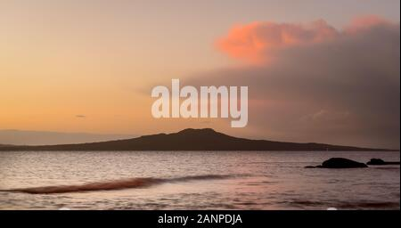 View of Rangitoto Island from Milford beach Auckland New Zealand - Stock Photo