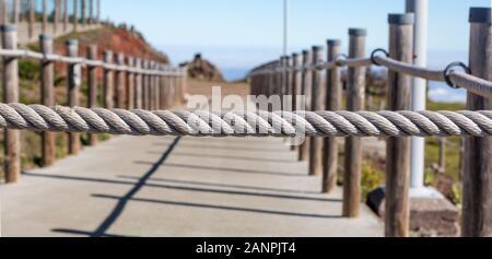 banister railing on marine rope - Stock Photo