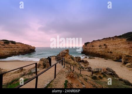 Praia de Albandeira at dusk, Algarve, Portugal. - Stock Photo