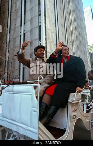Coretta Scott King and the Reverend Jesse Jackson waving to crowds during a Martin Luther King, Jr. Day parade in Atlanta, Georgia during the 1980s. - Stock Photo
