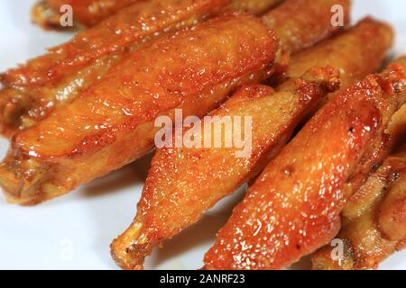 Closeup Thai Style Deep Fried Spicy Chicken Wings - Stock Photo