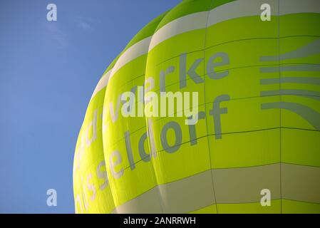 Wershofen, Germany  03 September 2017. Launching a green hot air balloon, close up of balloon canopy. In the background the blue sky. - Stock Photo