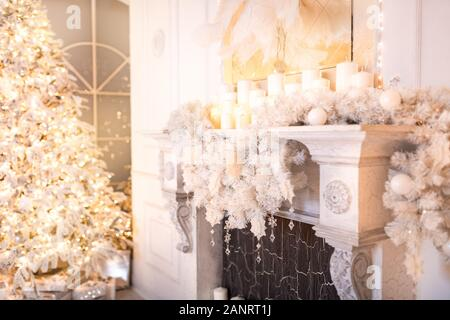 Background christmas interior New Year tree and artificial fireplace decorated light for holiday, white color - Stock Photo