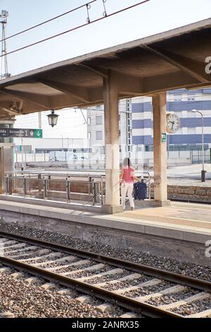 Woman walking up the stairs of a train station. Concept of travel - Stock Photo