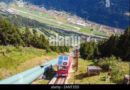 Aerial view of the Piora Valley with the village Piotta, the Ambri Airport and the Ritom funicular railway on a sunny day. Switzerland. - Stock Photo